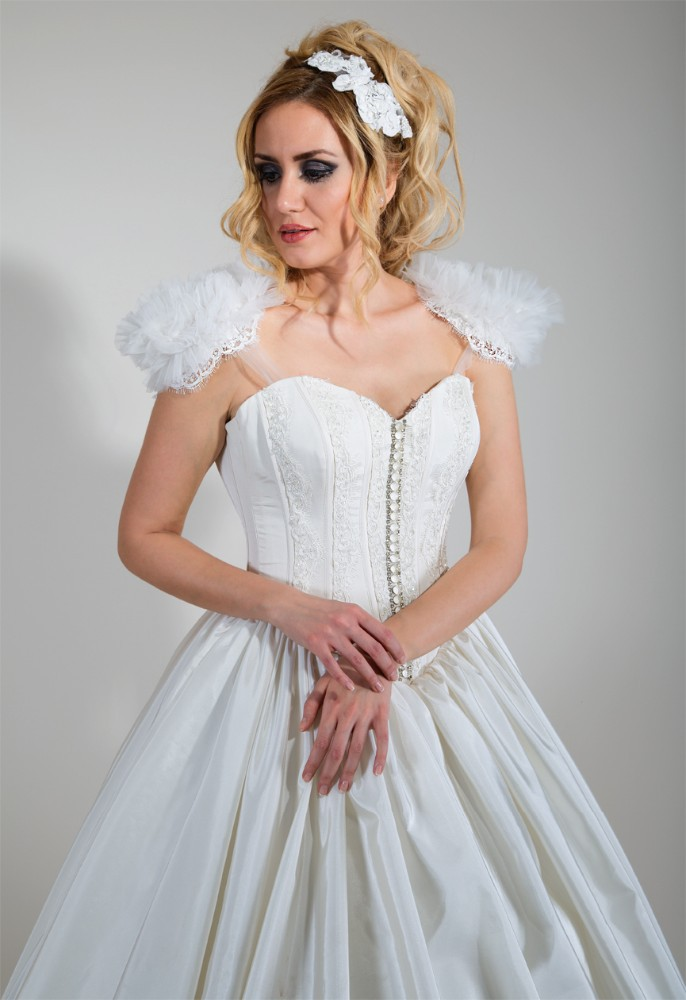 Wedding dress, lace body, Taffeta hemline, fur shoulder, pearl buttons embroidered