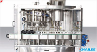 Sauces Filling Machine - Automatic Rotary Vaccum Filling & Capping Machine