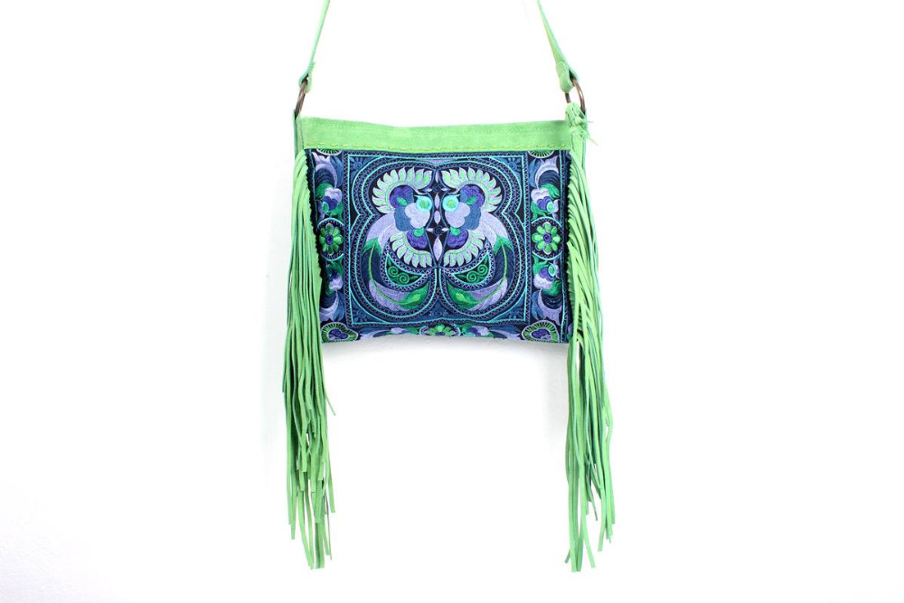 Brilliant Cross Body With A Blue Bird Embroidered Pattern, Adorned With Lime Leather Tassel