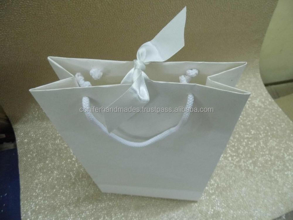 exquisite white handmade paper bags with ribbon tie in handles suitable for weddings also available with logo print