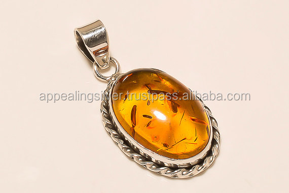 2017 Generous baltic amber oval shape gemstone sterling silver cabochon pendant