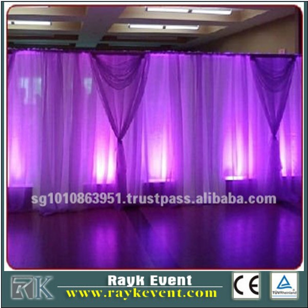 Wedding mandap photo booth pipe and drape round wedding centerpiece and flower stand