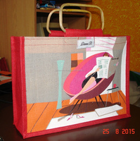jute bag Small size red color jute bag printed with lady reading news paper having cane handle