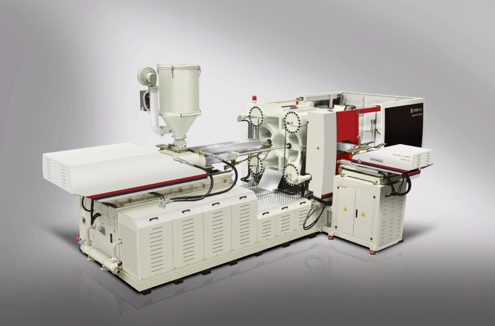 Multi-component hybrid two-platen injection molding machine