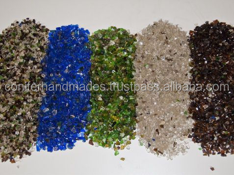 glass chips in assorted colours available with holes suitable for jewelry makers and bead stores and also used for floor tiles