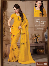 Yellow color printed saree with styles blouse pics.
