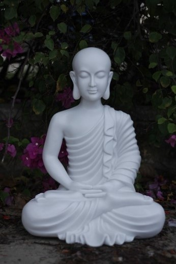 White marble resin meditating Buddha statue