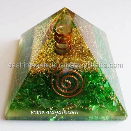 Wholesale orgone pyramids with green mica chips and charge crystal point