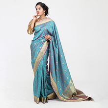 Turquoise faux silk jacquard saree with zari border and rich pallu