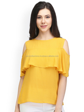 Yellow shoulder cut style top