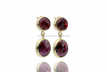 Stylish artisan crafted earring featured with Garnet set in gold plated Silver