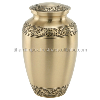 Solid brass cremation urns with engraved art