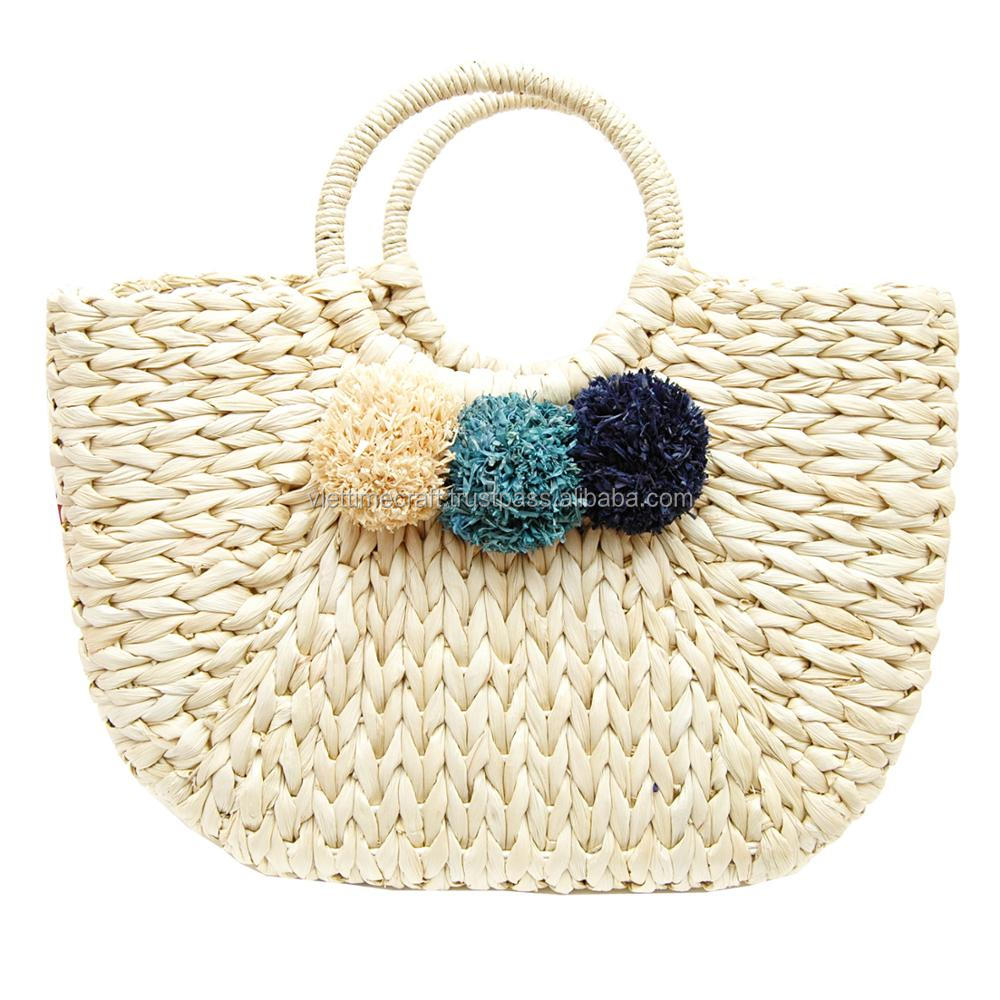 Fashionable water hyacinth pompom bag