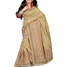 In Vogue Beige Color Fancy Saree.