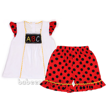 Adorable alphabet girl smocked clothing