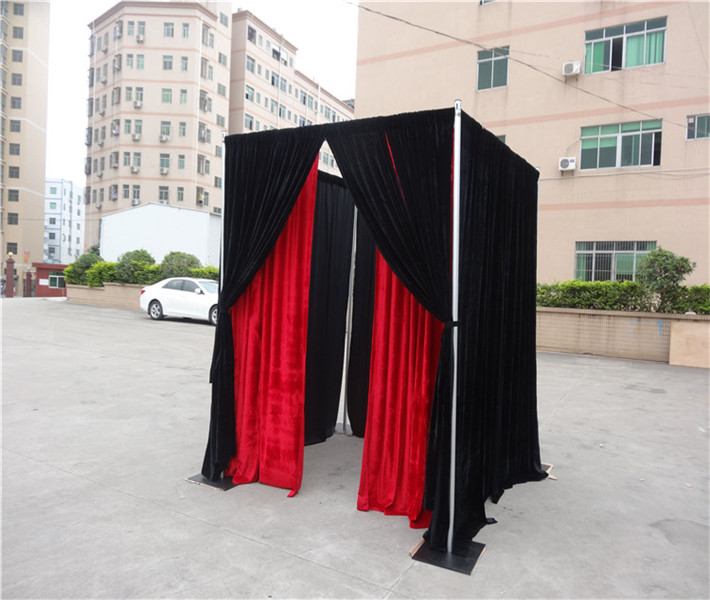 Photo booth made up with Black and Red Cloth for Photography stand