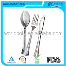 silver plastic cutlery.png