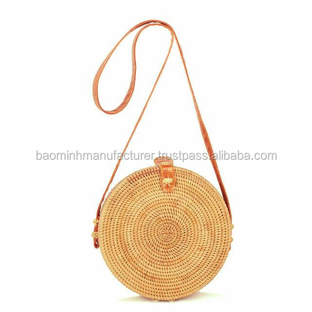 Fashionable rattan bag with long leather trap and round shape