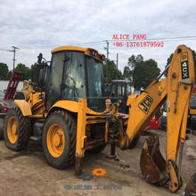 4x4 JCB 4CX compact tractor with loader and towable backhoe