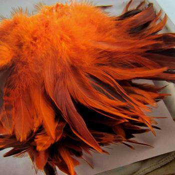GOOD QUALITY Dyed Orange Schlappen Coque Feathers