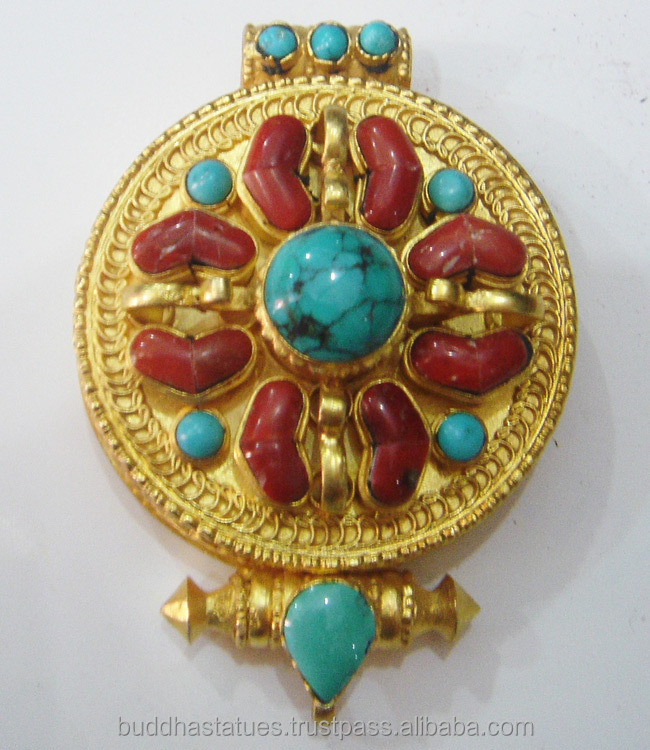 Ghau, a buddhist pendent with deity in silver and gold