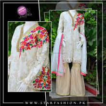 Exclusive Fancy Embroidered Net Outfit with colorful Thread Embroidery on Sideline. Brocade Gharara pants with fancy dupatta.