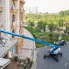 Hydraulic telescopic boom lift genie towable boom lift man lifts for sale