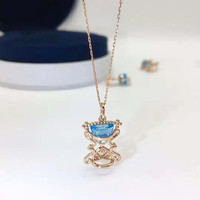 European and American retro hollow lace design 18K gold natural blue topaz hourglass shape real diamond pendant necklace