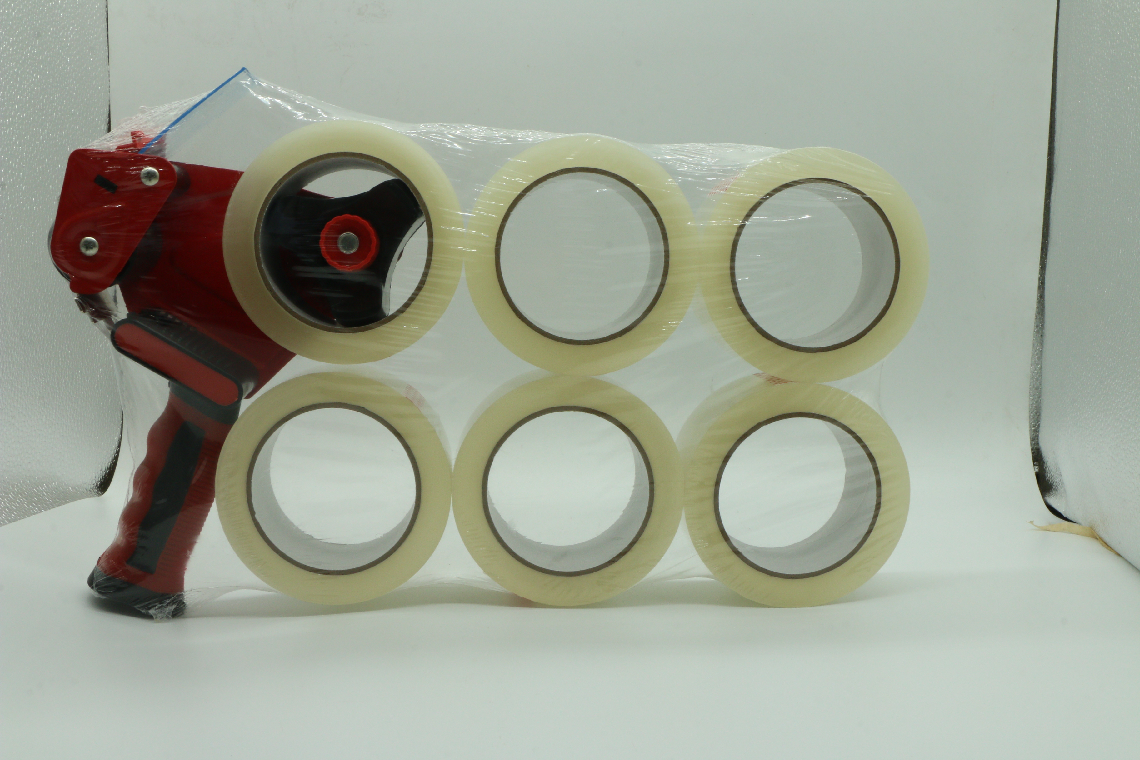 Clear packaging tape with red tape gun dispenser