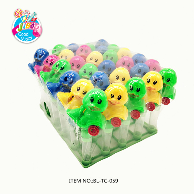New Type High Quality Colorful Cartoon Plastic Duck Shaped Motorcycle Toy Candy