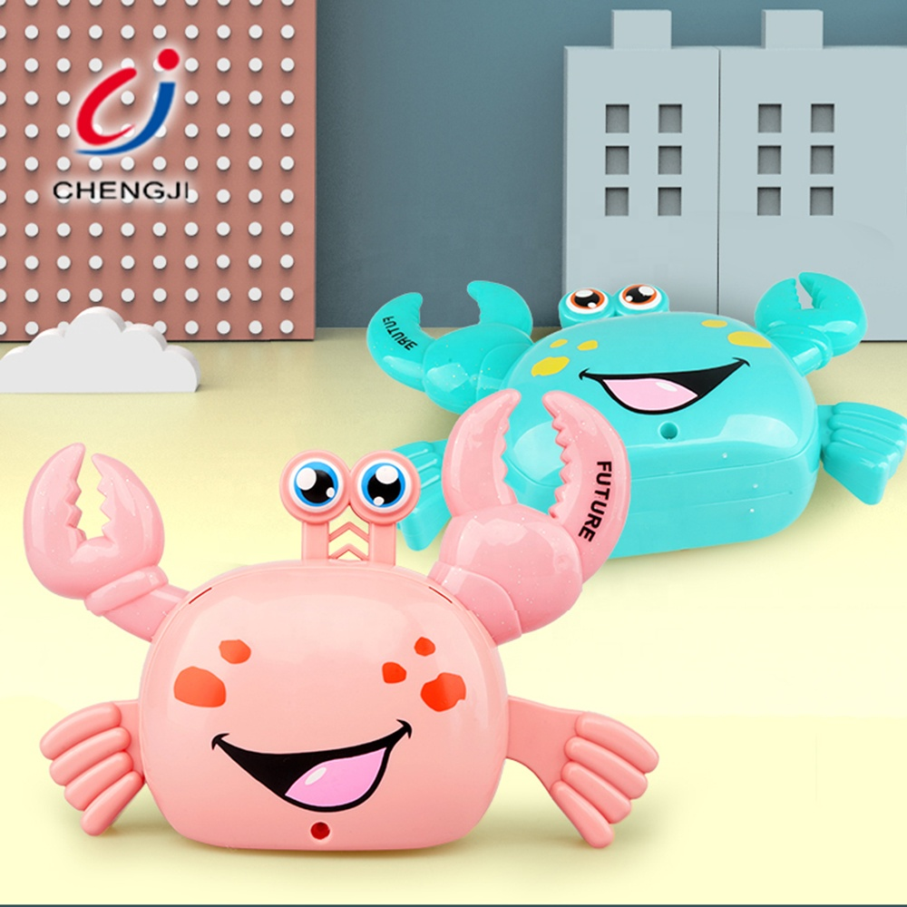 Children play electronic musical cartoon toy animal walking plastic crab