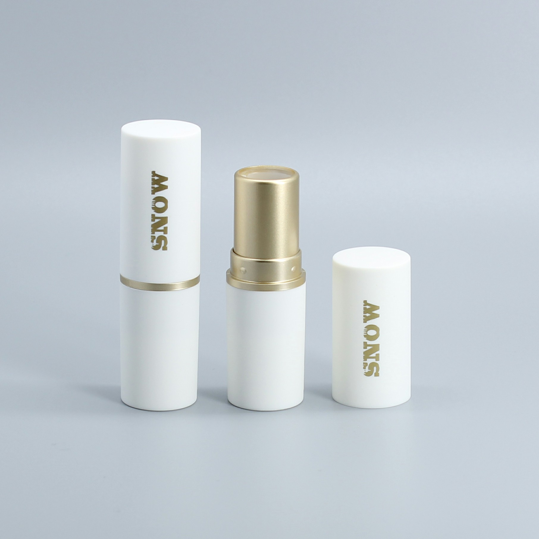 कस्टम सफेद प्लास्टिक खाली दौर लिपस्टिक ट्यूब पैकेजिंग सोने के साथ मध्य अंगूठी