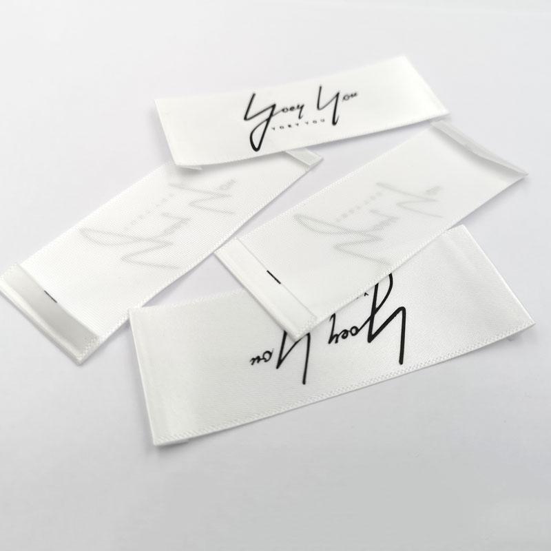 Direkt fabrik individuell bedruckte satin baumwolle garn stoff kleidung pflege label für bademode kleidung