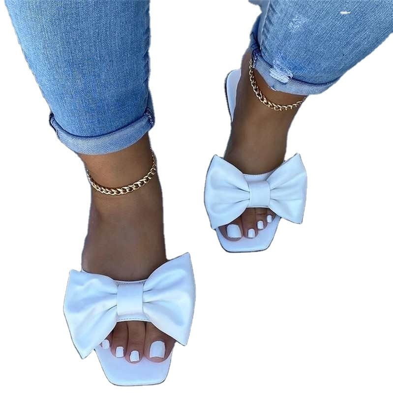 Large size ladies slippers 2020 summer European and American flat bow one word drag low heel sandals women's slippers