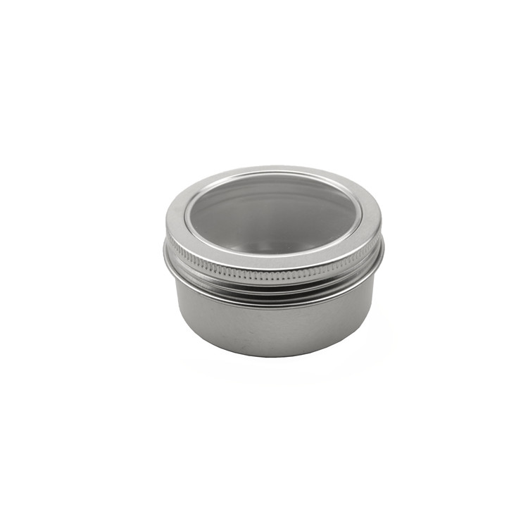empty 2oz round tin can with clear window lid for gift packaging. silver 2oz aluminum can with black sponge inside