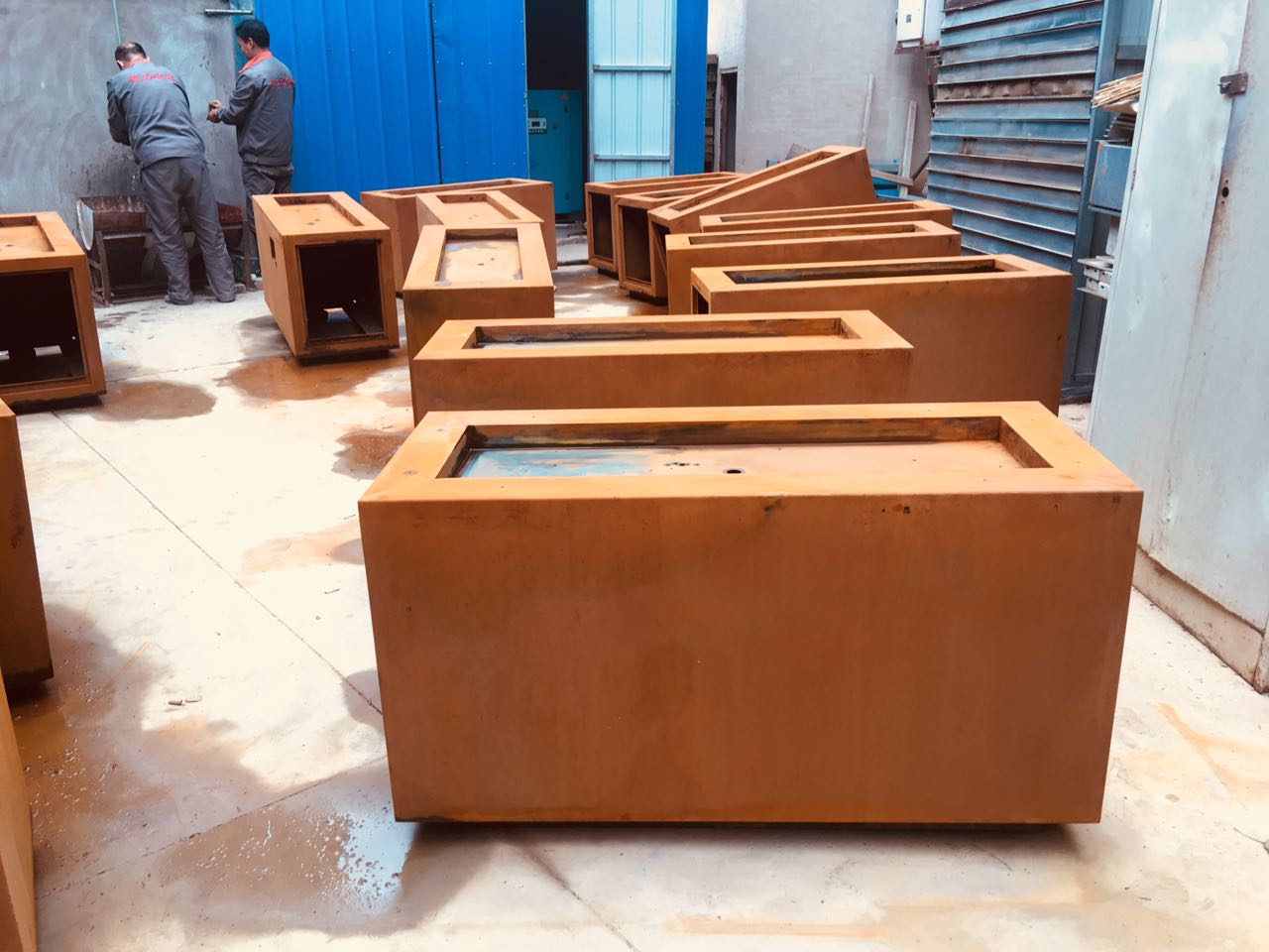 Corten a rusted steel propane gas fire pit
