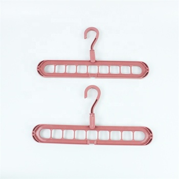 Wholesale non slip nine holes plastic magic hanger stand for clothes