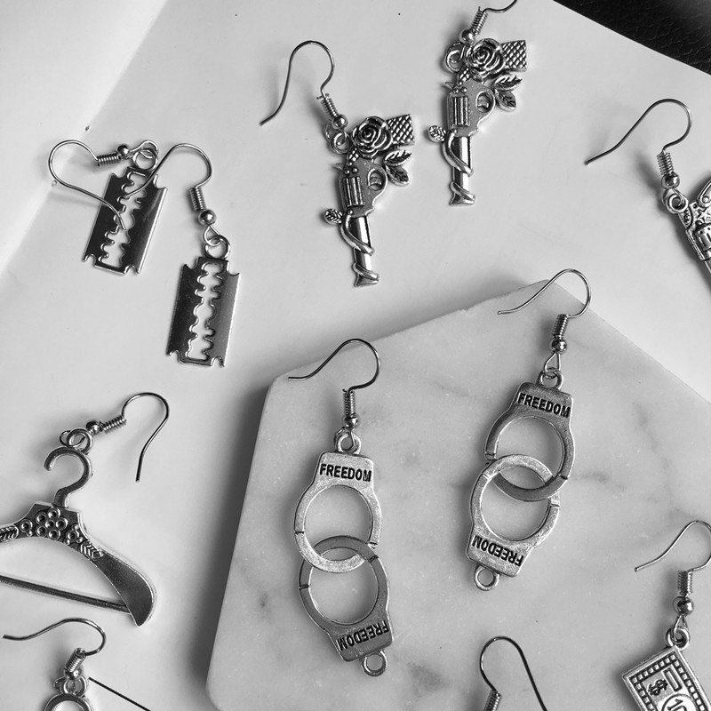 INS Funny punk jewelry wholesale creative rose pistol dollar handcuffs blade earrings customizable ear clips