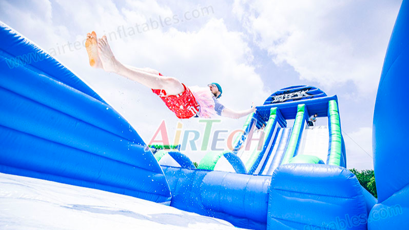 Used crazy inflatable drop kick water slide for adult