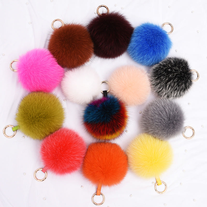 Various colors of <strong>fur</strong> pom pom <strong>keychain</strong> raccoon <strong>fox</strong> <strong>fur</strong> <strong>ball</strong> hats wholesale