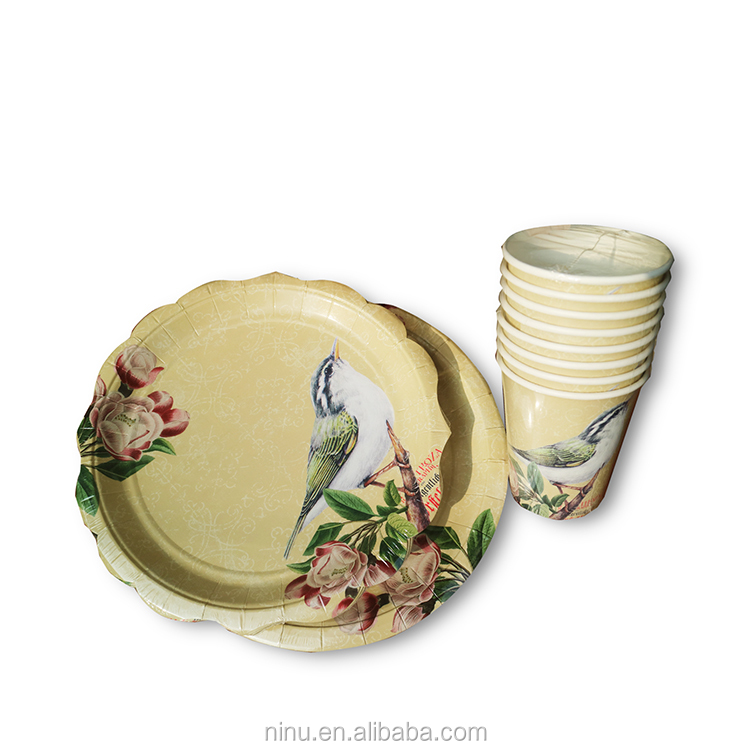 a group of printed paper cup and plate partyware set