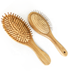 /product-detail/factory-price-custom-logo-natural-bamboo-bristle-oval-hair-straightener-brushes-62290080496.html