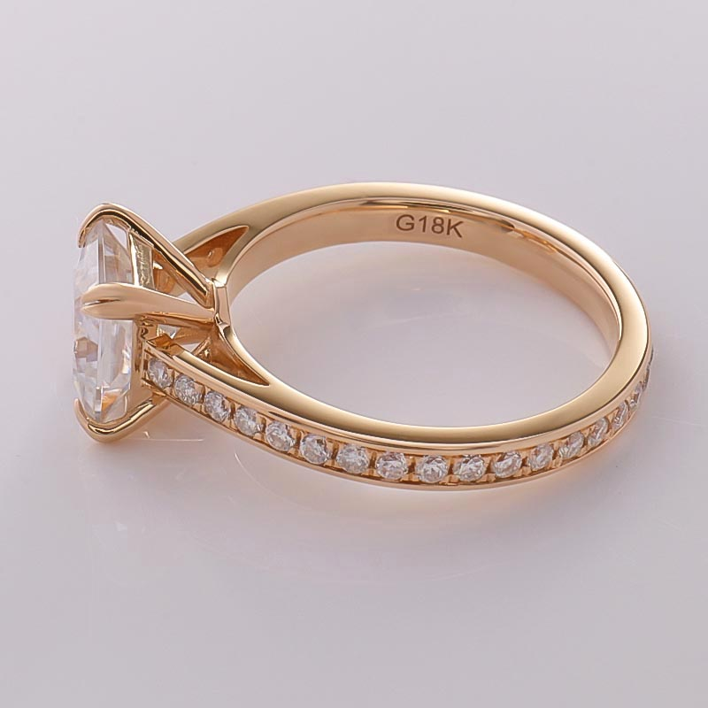Princess cut moissanite diamond 18carat rose gold engagement ring with accent stones on side