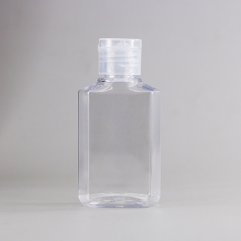 2 Ounce empty plastic bottle packaging with flip top cap