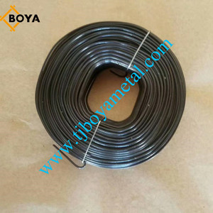 Small coils black annealed wire in plastic bucket
