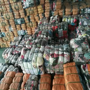 UK bulk cargo stock used clothes in bale second hand clothing export in low price for retailers in africa