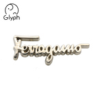 Garment hardware custom fashion metal brand logo embossed letter tag label sticker for clothing