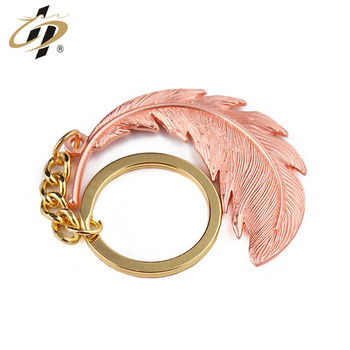 Inexpensive factory custom top quality Bright copper feather keychain custom logo