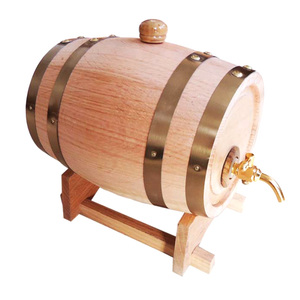 Rustic large handmade wooden whiskey barrels with metal tap
