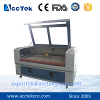Top quality fabric 3d CO2 laser cutting engraving machine with auto feeding and rolling system